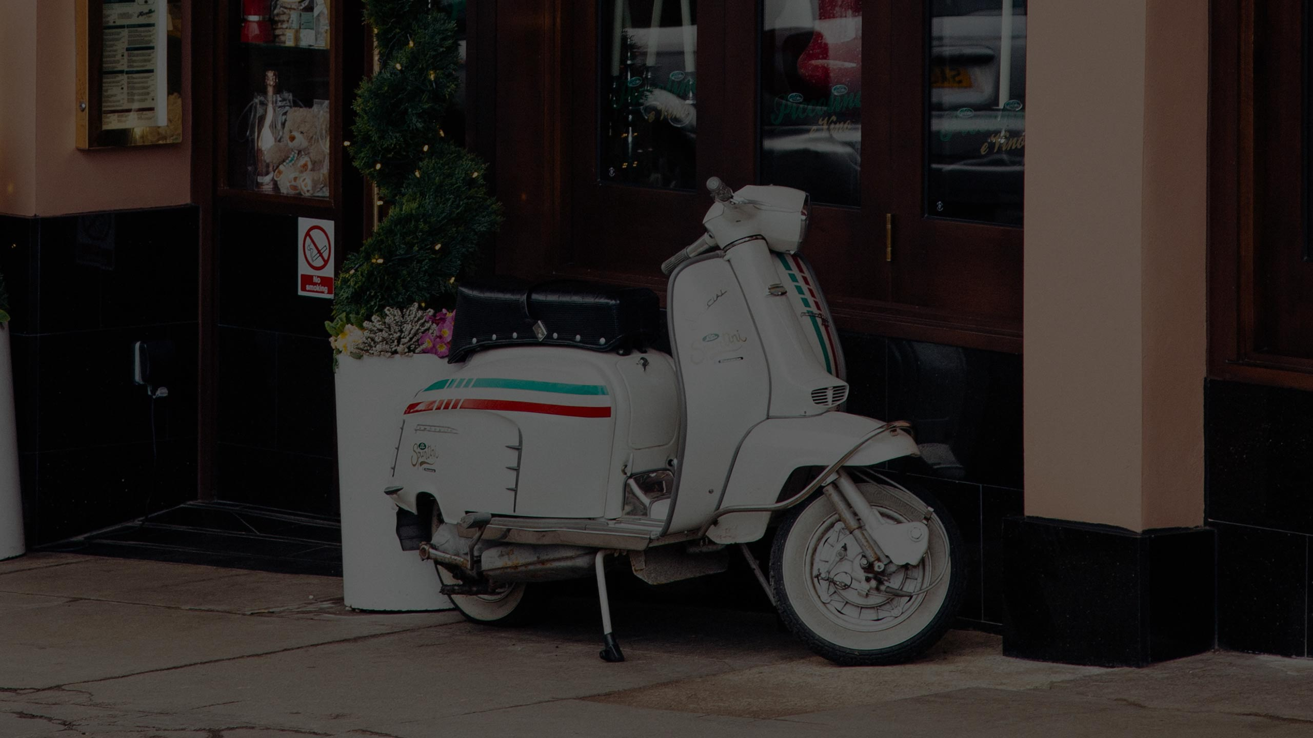 Italian scooter outside piccolino e vino southside