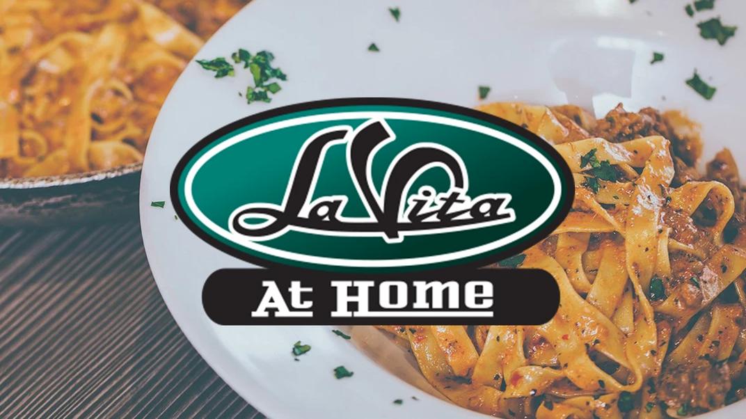 la vita at home logo over a bowl of pasta in tomato sauce